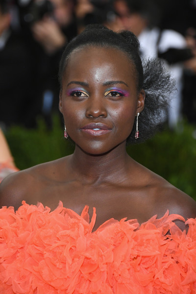 Lupita Nyong'o attended the 2017 Met Gala wearing her hair in a twisted bun.