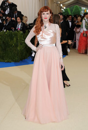 Karen Elson kept it modest and sweet in a long-sleeve pink gown by Lanvin at the 2017 Met Gala.
