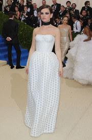 Lily James cut a shapely silhouette in this strapless white corset gown by Burberry at the 2017 Met Gala.