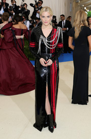 Riley Keough went for a royalty-meets-rock-star vibe in this chain-embellished black and red sequin gown by Louis Vuitton at the 2017 Met Gala.