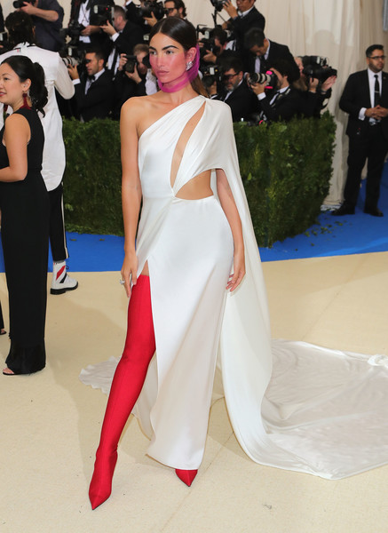 Lily Aldridge gave her white dress a shock of color with a pair of scarlet thigh-high boots by Balenciaga.