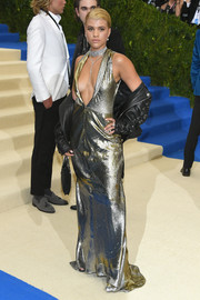 Sofia Richie was sexy, edgy, and glam all at once in a metallic Topshop gown with a navel-grazing neckline during the 2017 Met Gala.