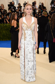 Sophie Turner opted for an edgy-glam embroidered column dress by Louis Vuitton when she attended the 2017 Met Gala.