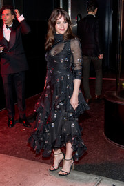 Felicity Jones went sweet and demure in a floral-embroidered ruffle dress by Erdem at the Met Gala after-party.