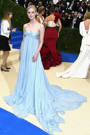 Elle Fanning was a drop of heaven in a pleated pastel-blue empire gown by Miu Miu at the 2017 Met Gala.