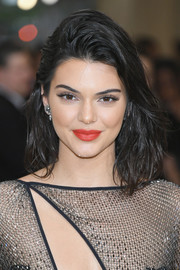 For her lips, Kendall Jenner chose a red-orange hue that really brightened up her beauty look.
