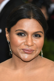 Mindy Kaling styled her hair into a center-parted chignon for the 2017 Met Gala.