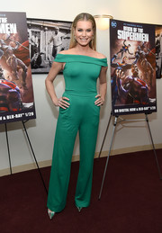 Rebecca Romijn looked breezy in a green off-the-shoulder jumpsuit by Jovani at the New York premiere of 'Reign of the Supermen.'