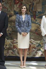 Queen Letizia of Spain teamed nude Magrit pumps with a recycled tweed jacket and a white pencil skirt for the Reina Letizia Awards.