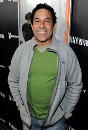 Oscar looked fun and sporty in a gray track jacket and green V-neck shirt.