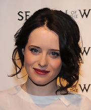 Claire Foy styled her brunette locks in a loos bun complete with soft curls.
