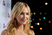 Arielle Kebbel paired her tousled locks with orange gemstone earrings.