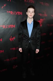 Cameron Monaghan looked elegant in a timeless black suit at 'The Raven' Los Angeles premiere.
