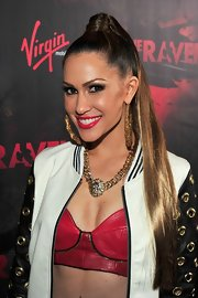 Kimberly Cole swept her hair up into a sleek ultra-long ponytail for the premiere of 'The Raven.'