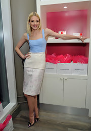 Jaime King showed off her petite frame with a pale blue bustier top paired with a tiered tweed-like pencil skirt.