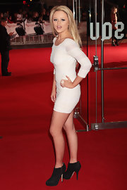 Emily Atack turned heads on the red carpet in this mini white cocktail dress.