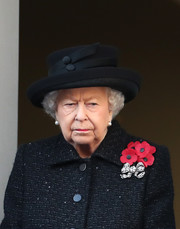 Queen Elizabeth II paired a decorative hat with a tweed coat for the Remembrance Sunday Cenotaph Service.