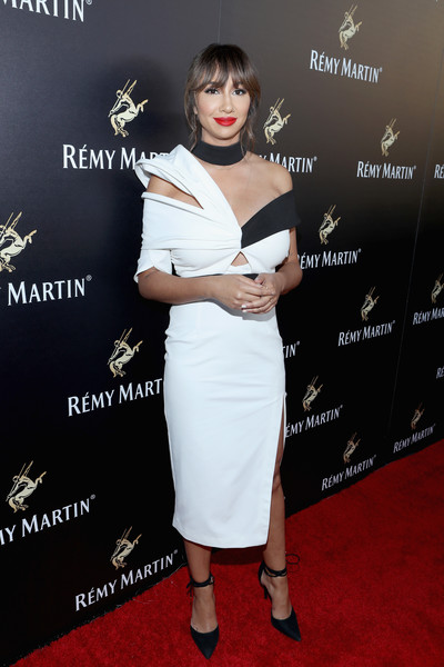 Jackie Cruz was modern and sexy in a monochrome off-one-shoulder peekaboo dress by Asilio during Remy Martin's special evening with Jeremy Renner.