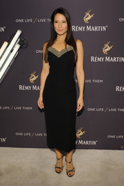 Lucy Liu cut a shapely figure in a fitted LBD with an embellished sweetheart neckline during the One Life/Live Them event.