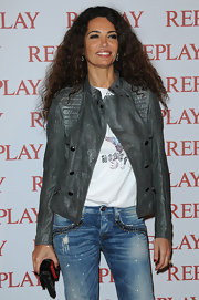 Afef Jnifen arrived in a very stylish gray leather jacket at the Replay Party during the Cannes Film Festival.