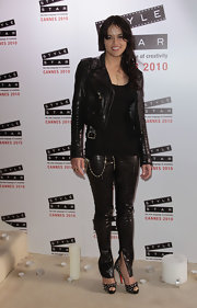 Michelle looked like a sexy biker babe in a latex and leather black ensemble, completed by a dangerous pair of silver spike Very Prive Pumps. Hot!