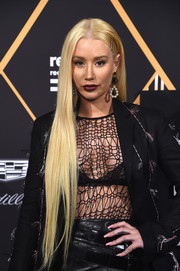Iggy Azalea was edgy-sexy in a black mesh top layered under an embellished blazer.