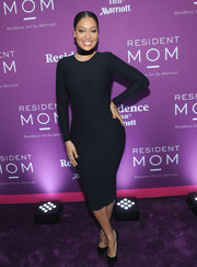 La La Anthony struck a pose at the Red Cross Moms celebration wearing a skintight LBD.