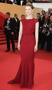 Mia donned a sheath dress in a lovely Merlot for the Cannes Film Festival.