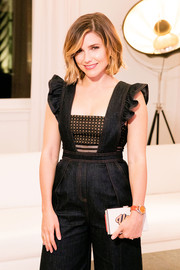 Chicago PD star Sophia Bush rocked a fashion-forward frilled denim jumpsuit by Self Portrait when she attended the opening of Restoration Hardware Chicago. Bush paired the look with cheetah-print heels and a box clutch. She kept her makeup simple and her bob loose and wavy.