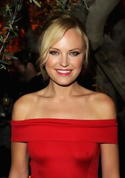 Malin Akerman paired a shiny cranberry shade of lipstick with her classic red dress at the Restoration Hardware spring 2012 collection launch.
