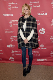 Brooklyn Decker topped off her outfit with a cozy plaid cape.
