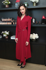 Gal Gadot looked impeccable in a red wrap coat dress by Gabriela Hearst at the Revlon Brand Ambassador media event.