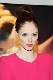 Coco Rocha kept her look streamline and sleek with this classic twisted top bun.