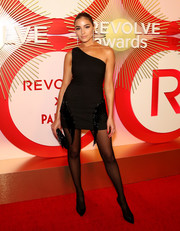 Olivia Culpo slipped into a black NBD x Naven one-shoulder dress with fringe detailing for the #REVOLVEawards.