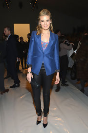 Maggie Grace's black skinny pants completed her polished ensemble while attending a show during NY Fashion Week.