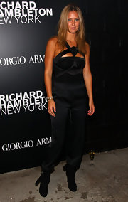 Bar Refaeli loves a daring jumpsuit! The model donned a black cut-out style for the Richard Hambleton event.