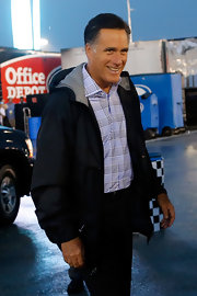Mitt Romney geared up for a rainy day in a hooded black windbreaker.