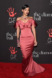 Rihanna covered up for a change for the Diamond Ball, and she looked fabulous! The rose-colored off-the-shoulder gown with architectural detailing was by Zac Posen.