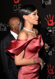 Rihanna attended the Diamond Ball wearing a pink cuff that clashed with her wrist tattoo.