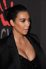 Kim Kardashian looked a little pale with her nude lipstick.