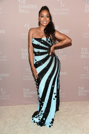 La La Anthony looked vibrant in a dotted and striped strapless gown by Georgine at the Diamond Ball.