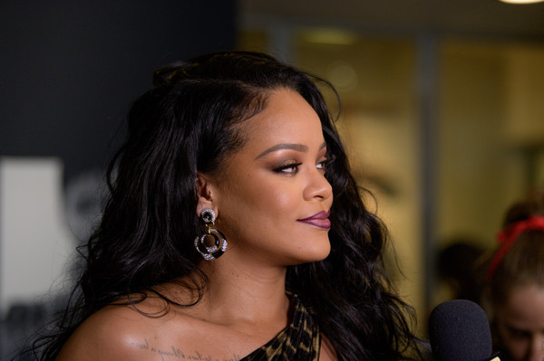 Rihanna Diamond Hoops [autobiography,hair,eyebrow,hairstyle,black hair,beauty,lady,chin,lip,cheek,forehead,rihanna,new york city,guggenheim museum,rihanna launch event,launch]
