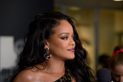 Rihanna accessorized with a pair of two-tone diamond hoops by David Webb at the launch of her visual autobiography.