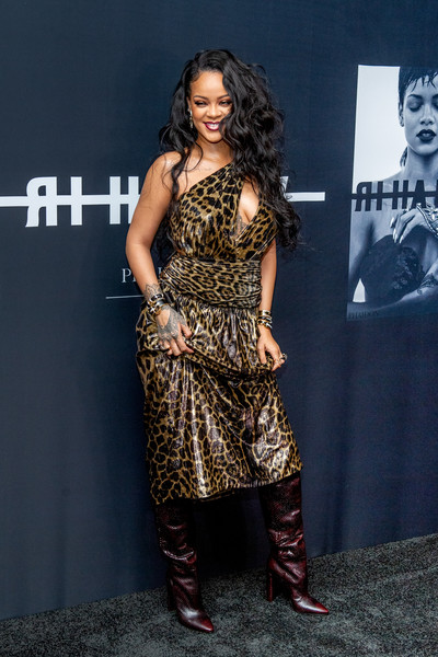 Rihanna styled her look with slouchy burgundy boots, also by Saint Laurent.