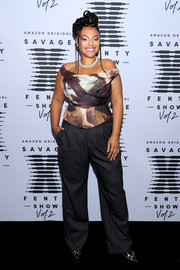 Paloma Elsesser paired her top with charcoal pinstriped pants.