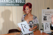 Recording artist Rihanna signs copies of
