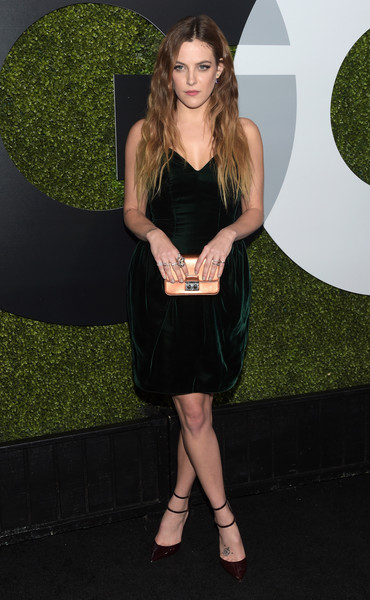 Riley Keough Metallic Clutch [clothing,dress,cocktail dress,little black dress,hairstyle,long hair,footwear,carpet,leg,flooring,arrivals,riley keough,gq 20th anniversary men of the year party,california,los angeles,chateau marmont,gq men of the year party]