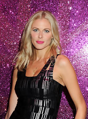 At the Rimmel party celebrating their 10-year partnership with Kate Moss, Donna Air wore some hot, hot pink lipstick. To duplicate Donna's look, we recommend Rimmel Moisture Renew Lipstick in Rose Passion.