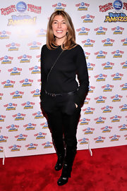 Nina Garcia chose a pair of black skinny pants for her red carpet look at the 'Built to Amaze' red carpet.