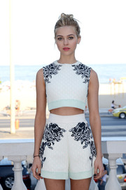 Nicola Peltz teamed her top with matching high-waisted Balenciaga shorts.